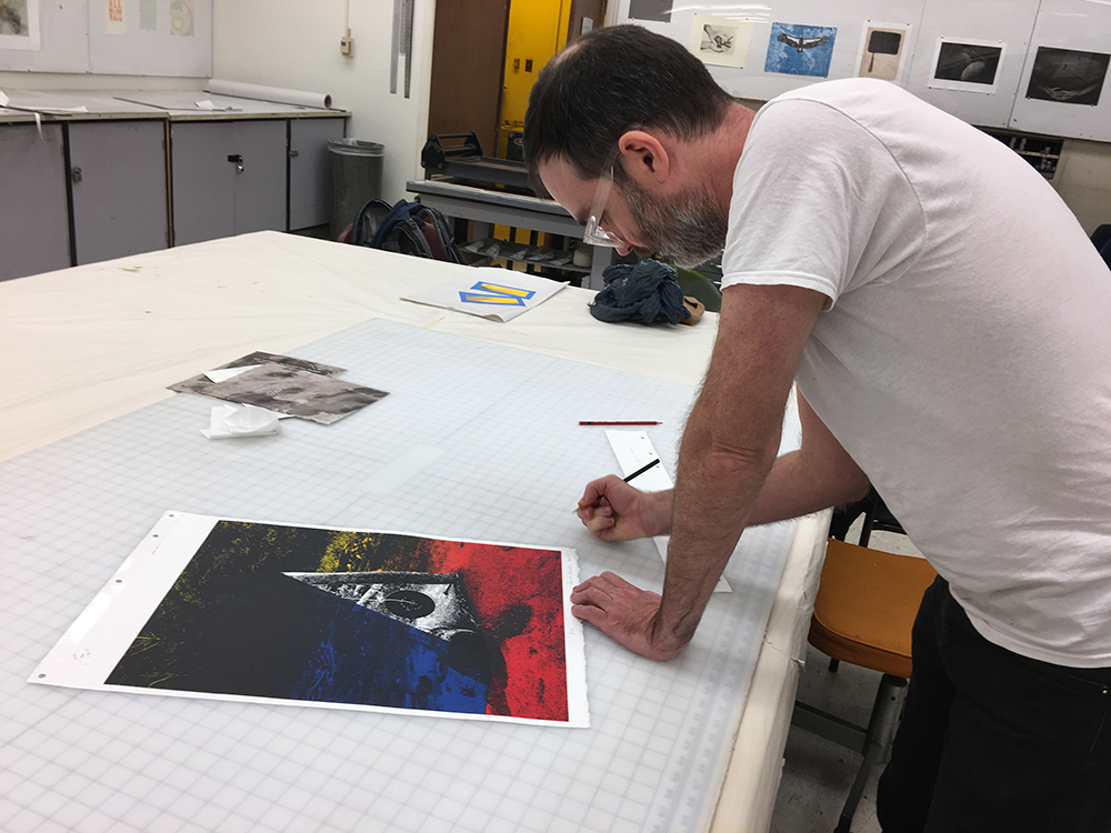 Artist Reuben Lorch-Miller signs his print at the 2017 Normal Editions Workshop.
