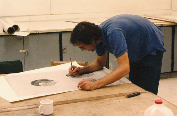 Artist David Wojnarowicz works on a drawing at the Normal Editions Workshop in 1990.
