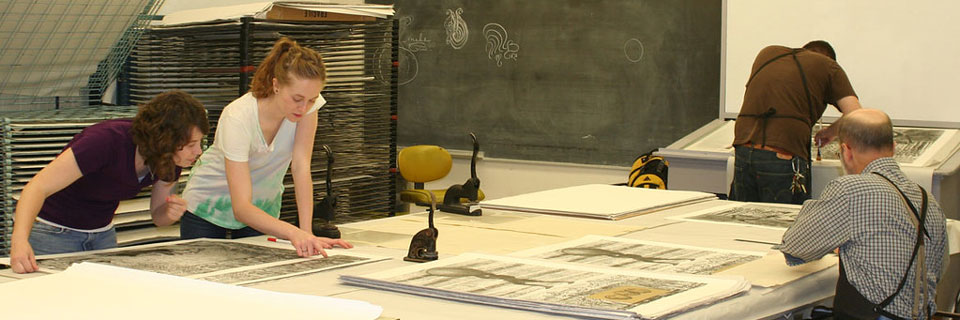 Students and faculty examining Gregory Page prints.